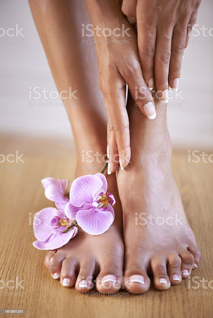 Happy hands and feet after a day at the spa royalty-free stock photo