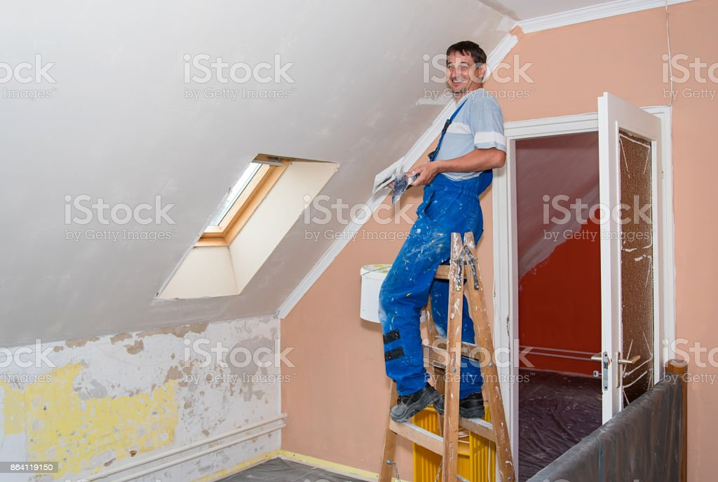 Happy hands plasterer at work royalty-free stock photo