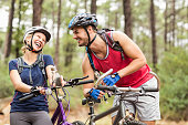 Happy handsome biker couple laughing in the nature