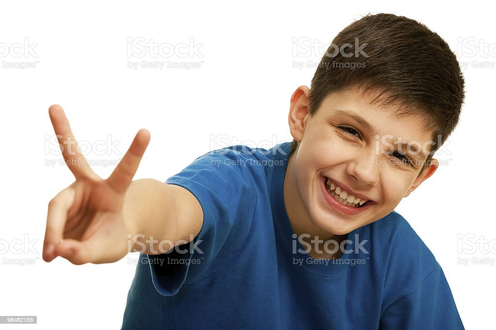 Happy handsome boy showing a victory sign royalty-free stock photo
