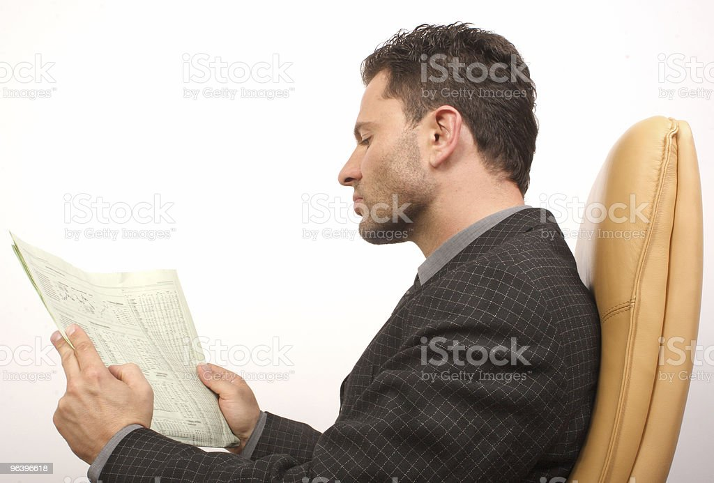 Happy handsome business man reading a newspaper royalty-free stock photo
