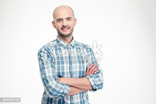 istock Happy handsome man in checkered shirt standing with arms crossed 504302702