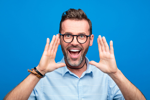 Happy Handsome Man Screaming Against Blue Background Stock Photo - Download Image Now
