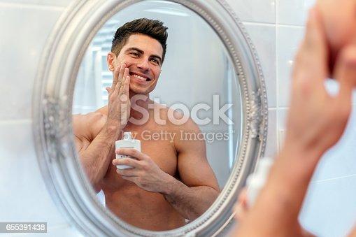 istock Happy handsome man shaving in bathroom 655391438