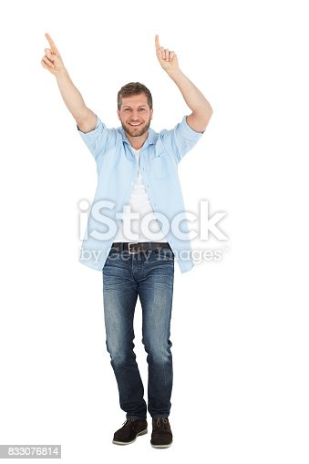 Happy handsome model dancing on white background