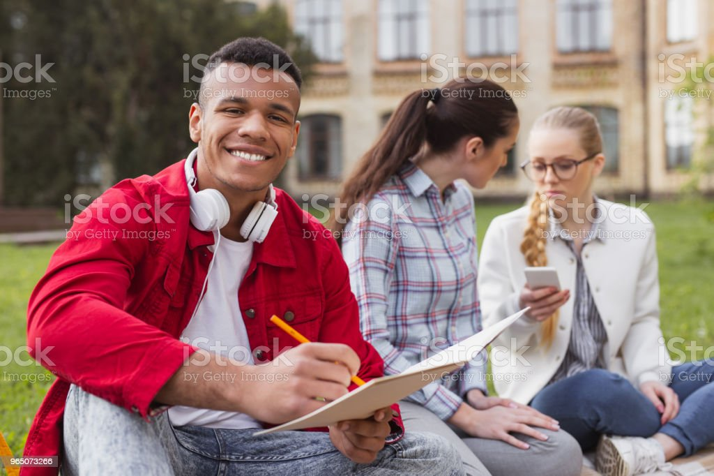 Happy handsome student writing notes in his planner royalty-free stock photo
