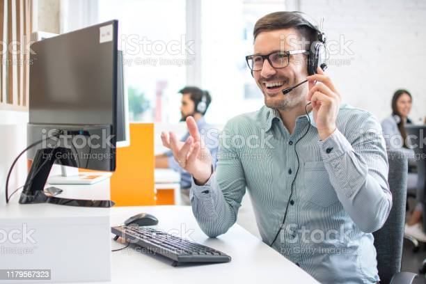 Happy handsome technical support operator with headset working in picture id1179567323?b=1&k=6&m=1179567323&s=612x612&h=f7hmio8obswiwo8la9v11cmeslvuez7ys7s5u3xx3nu=