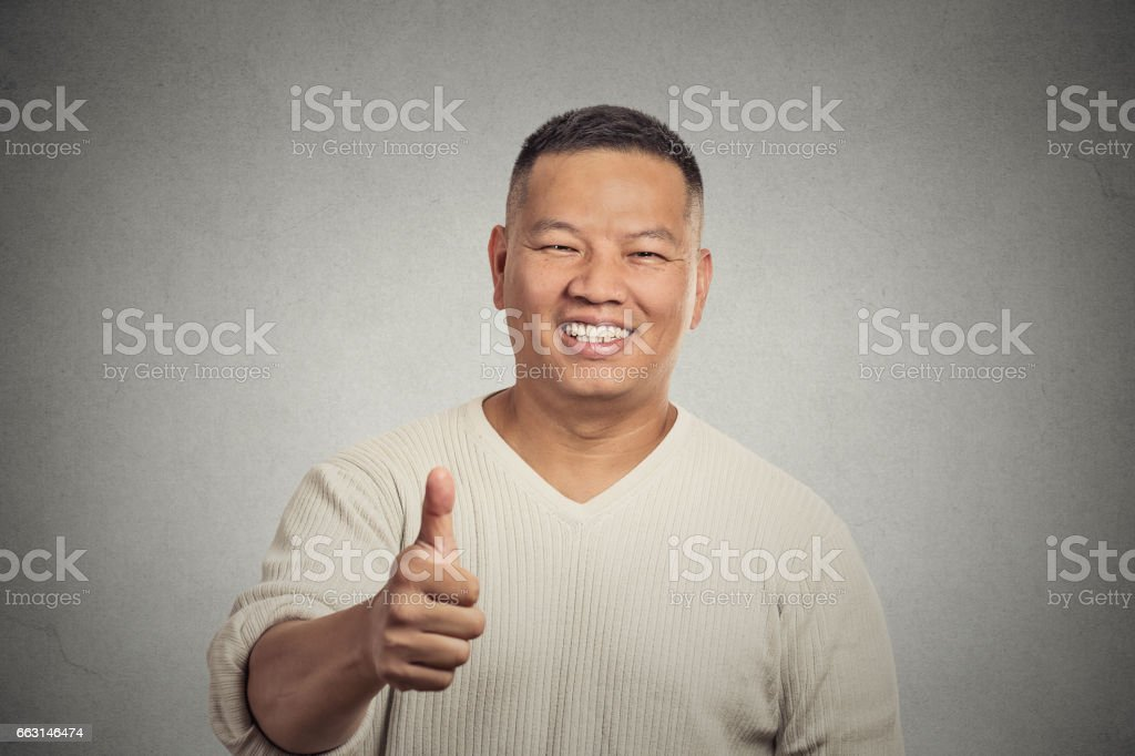 happy handsome young smiling man employee giving thumbs up sign stock photo