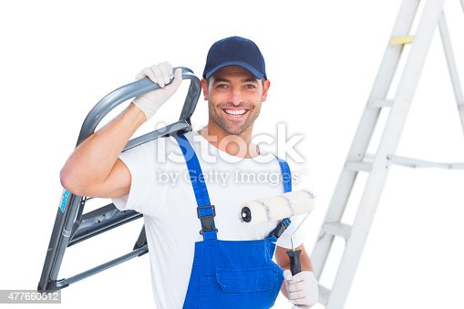 589454570 istock photo Happy handyman with chair and paint roller on white background 477660512