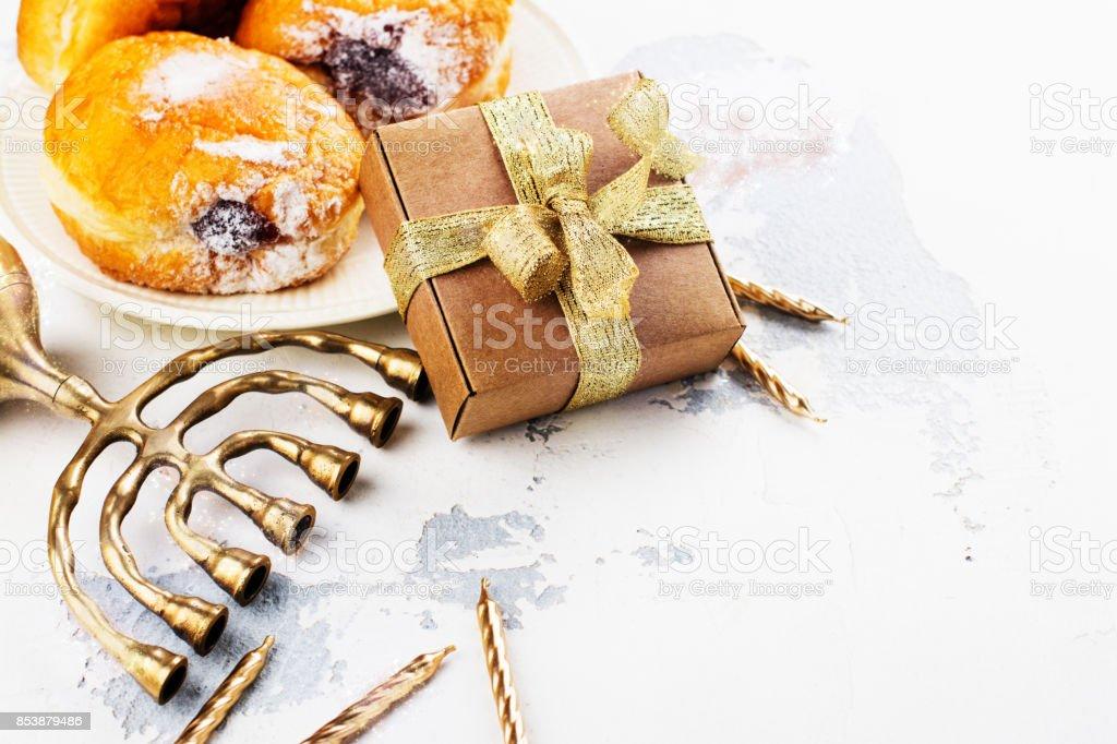 Happy Hanukkah background with menorah, burning candles and donu stock photo