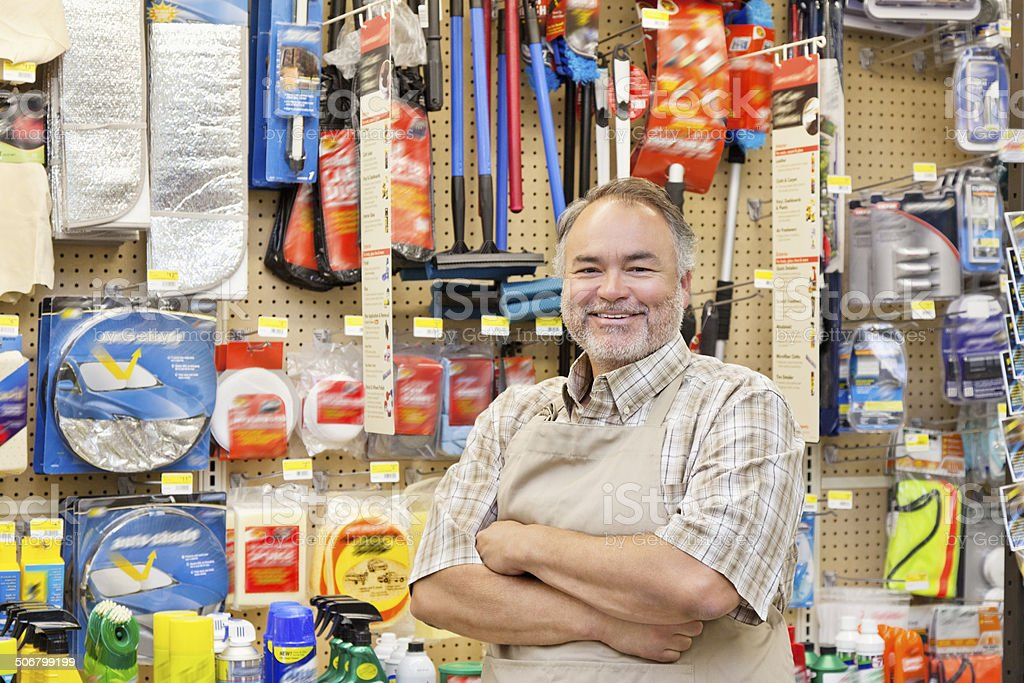 Happy Hardware Store Salesperson stock photo
