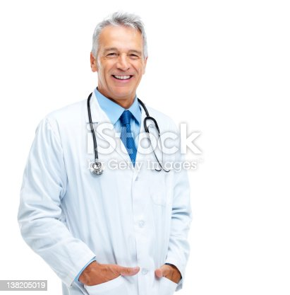 Portrait of happy mature medical doctor standing against white background