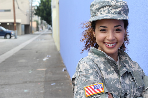 istock Happy healthy ethnic army female soldier 588996836