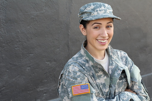 istock Happy healthy ethnic army female soldier 636949600