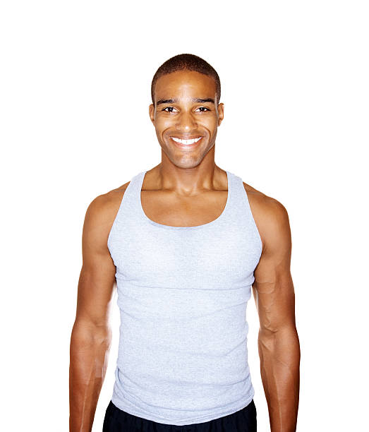 Man tank top pictures images and stock photos istock happy healthy man standing isolated against white stock photo urmus Choice Image