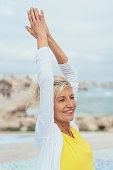 istock Happy healthy woman doing stretching exercises 1076784120