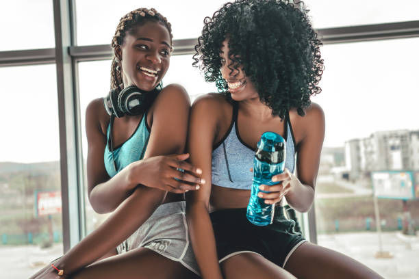 Happy healthy young African American woman working out in a gym stock photo