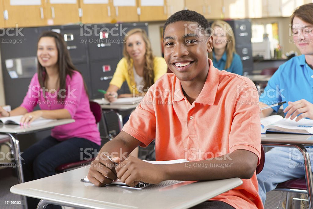 Happy high school student in class royalty-free stock photo