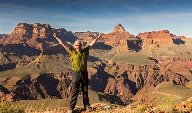 Happy Hiker enjoying views on Horseshoe Mesa, Grand Canyon of Arizona stock photo