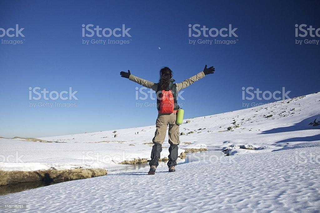 happy hiking female on snow stock photo