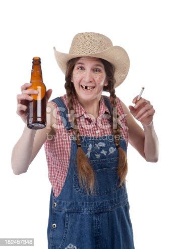 An isolated redneck woman smiling and holding a beer and a cigarette.