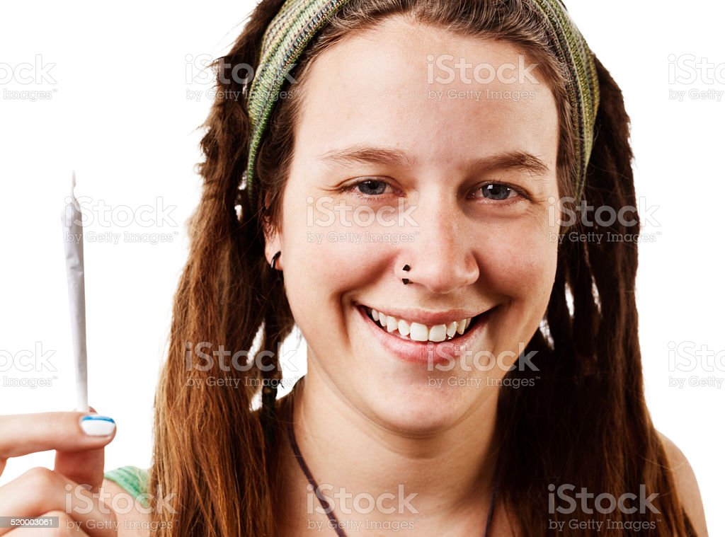 Happy hippie holding joint, rolled and ready to smoke stock photo