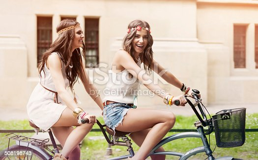 Happy hippie woman have fun on riding a tandem