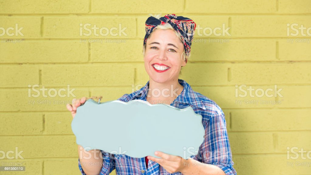 Happy Hipster Business Woman holding a blank Sign with space for Copy stock photo