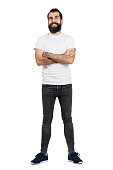 istock Happy hipster in white t-shirt and jeans with crossed arms 512906660