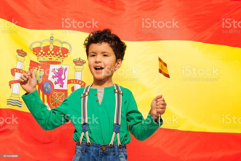 Happy Hispanic boy with Spanish flag in his hand stock photo