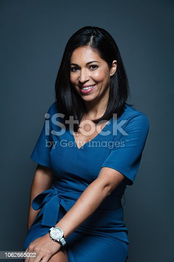 istock Happy Hispanic Businesswoman 1062665022