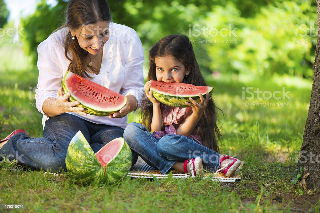 Happy hispanic family eating watermelon royalty-free stock photo