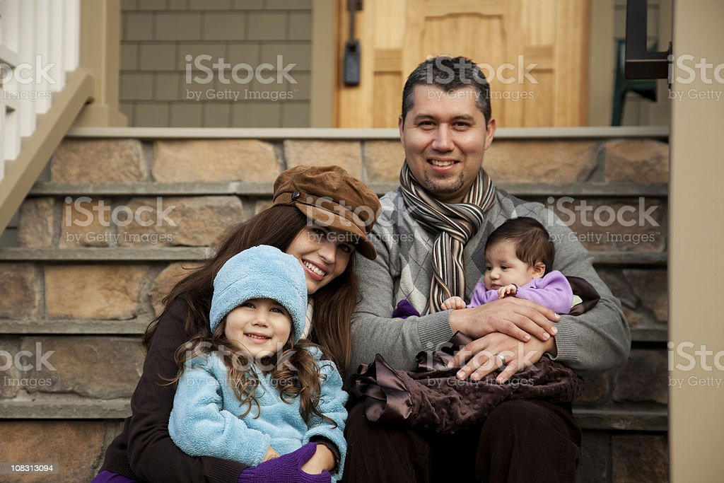 Happy Hispanic family move into their new home stock photo