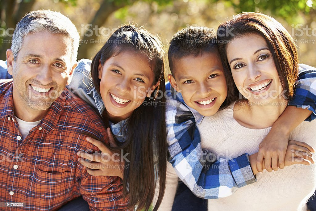 Happy Hispanic family outdoors in country stock photo