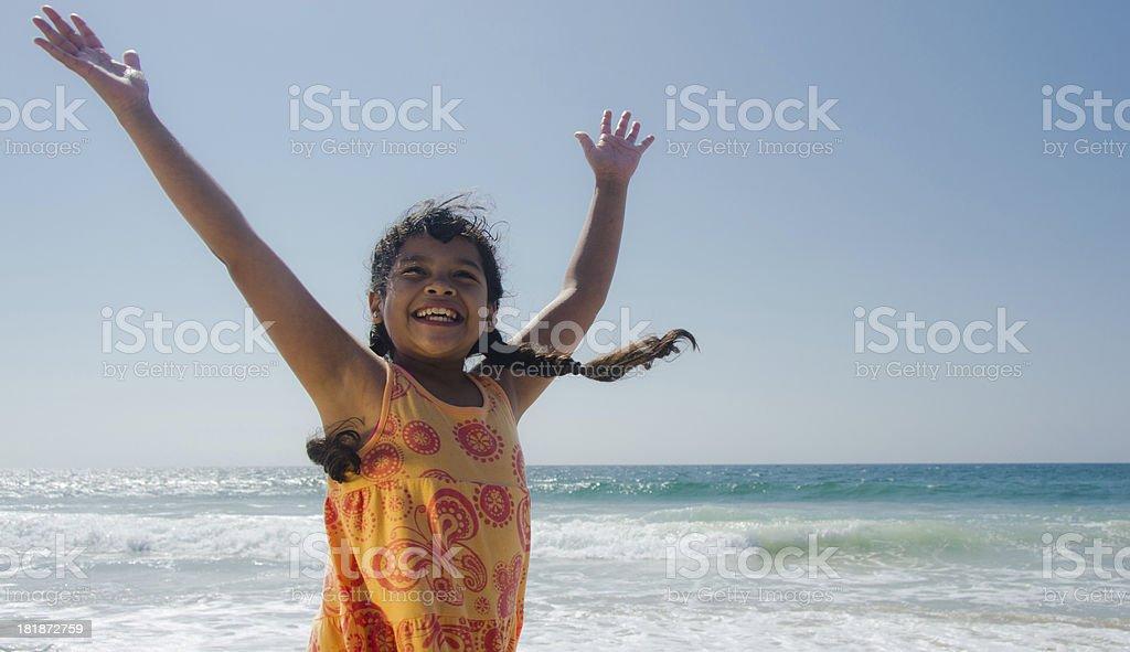 Happy Hispanic Girl Loving Beach Life royalty-free stock photo