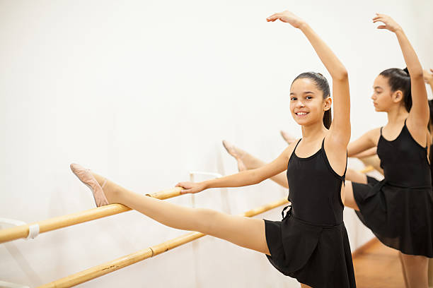 Happy Hispanic girls in a dance class stock photo