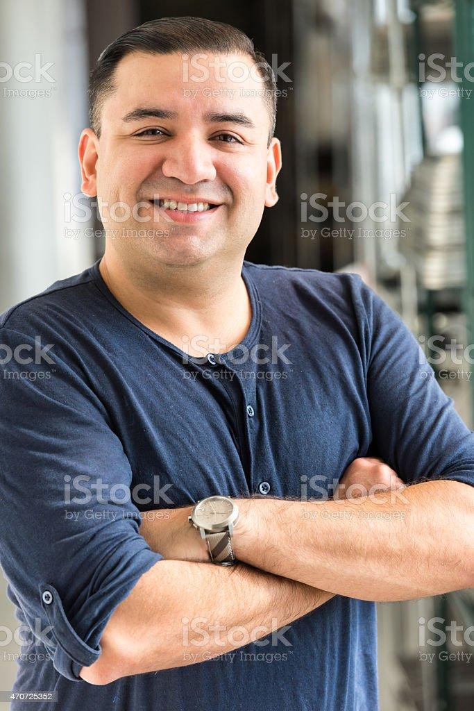 Happy hispanic man stock photo