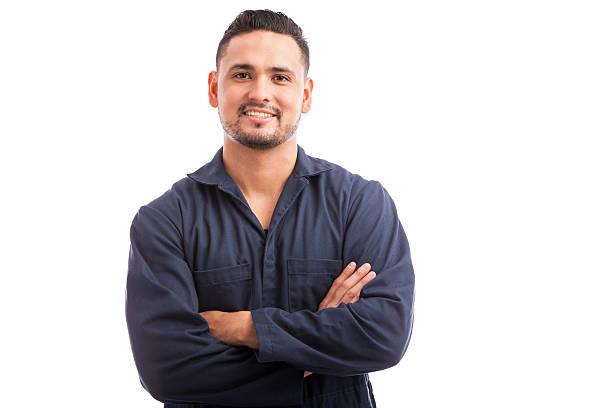 Happy Hispanic mechanic stock photo