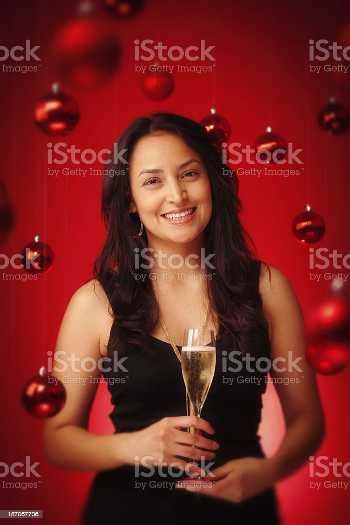 Happy Hispanic Model Celebrating Christmas with Champagne Vt stock photo