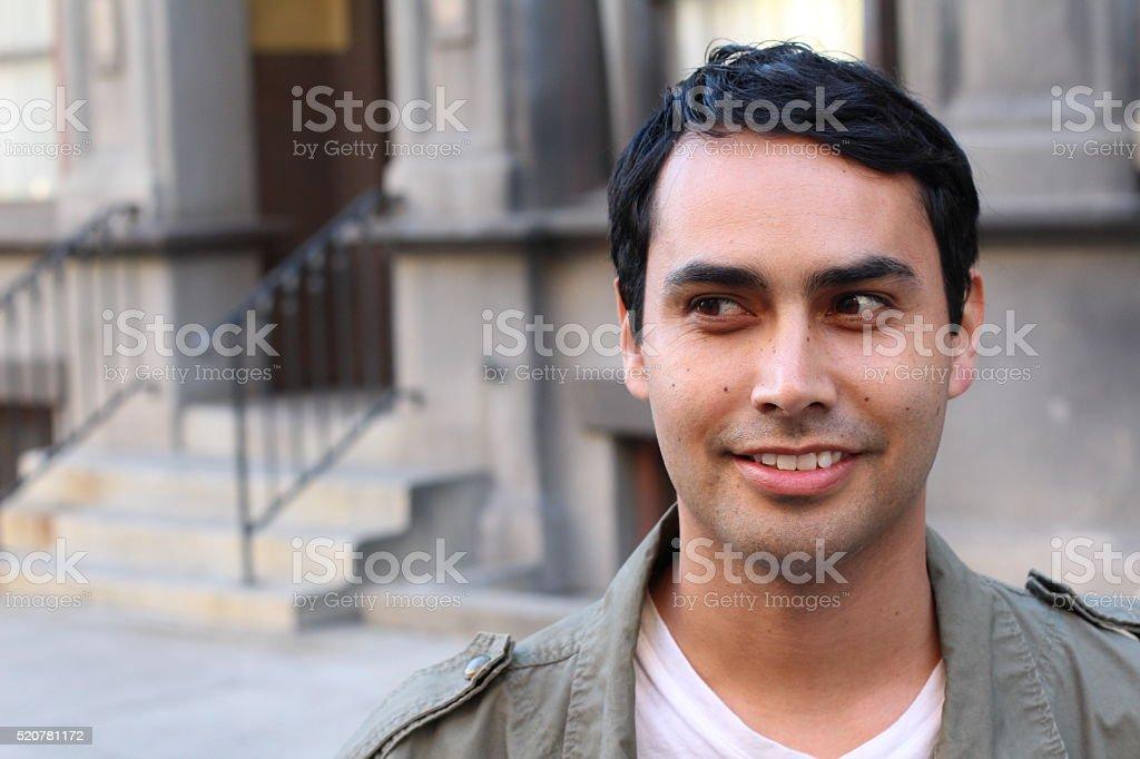 Happy Hispanic/Spanish man looking to left stock photo