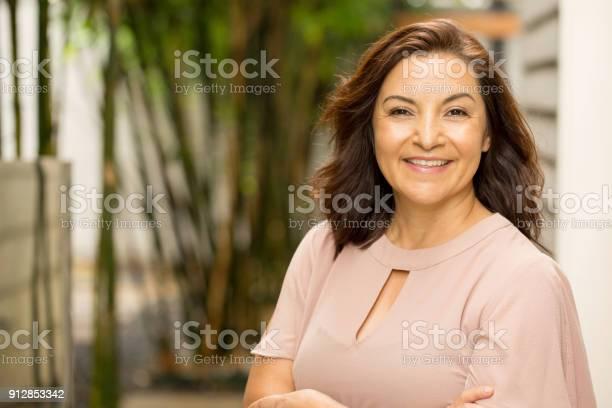 Portrait of a happy Hispnaic woman smiling.