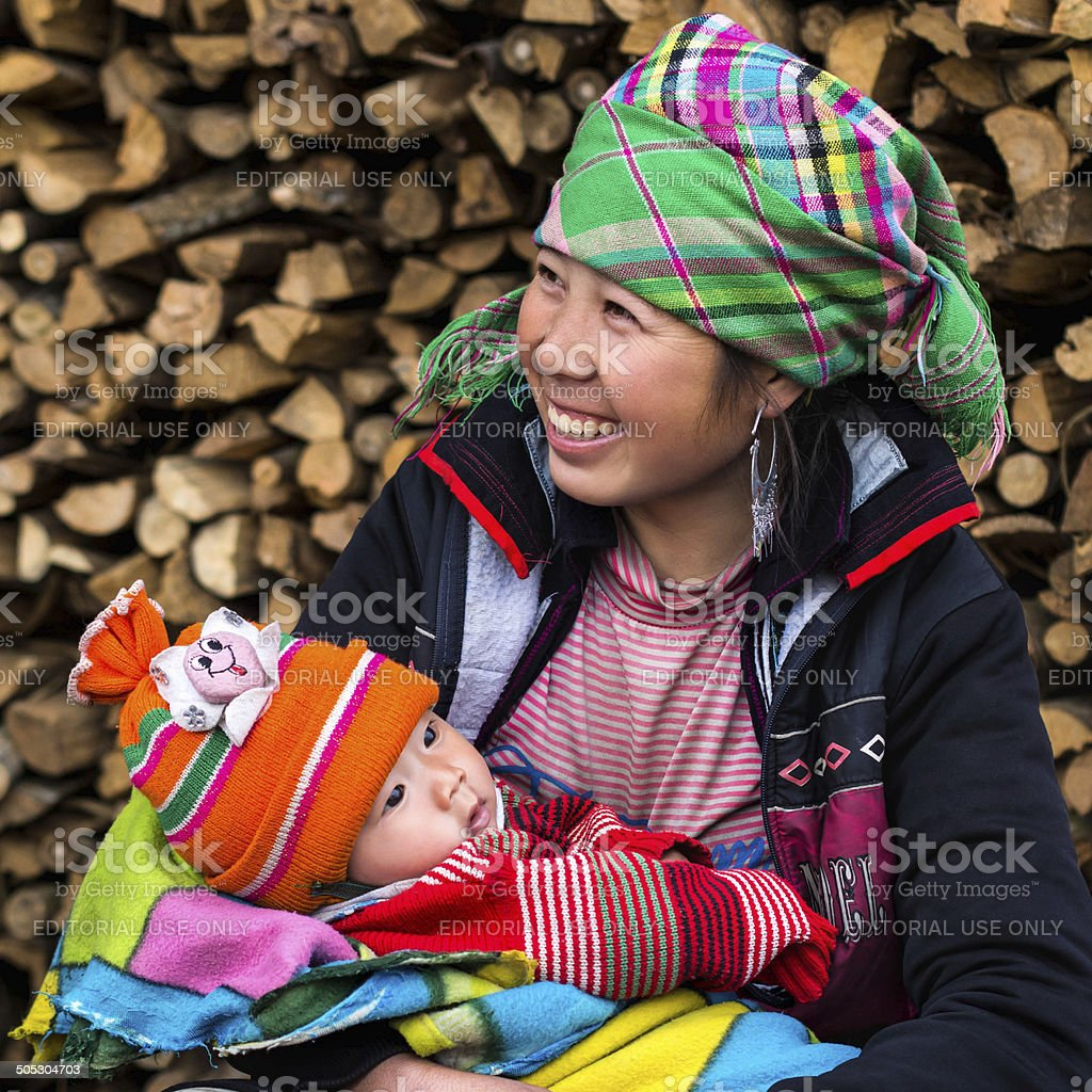 Happy Hmong Woman with Baby, Sapa, Vietnam stock photo