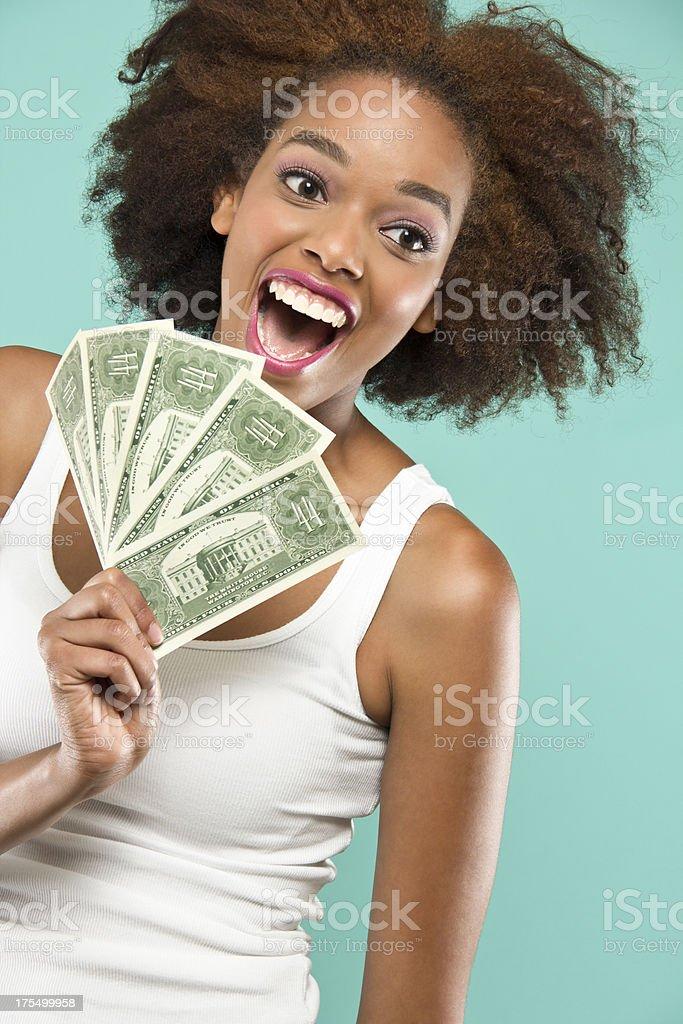 Happy Holding Money stock photo