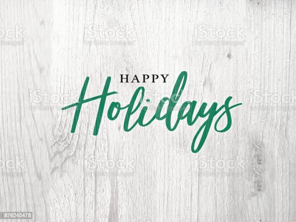 Happy holidays calligraphy text over white rustic wood background picture id876245478?b=1&k=6&m=876245478&s=612x612&h=ze81geogoo4l6ln69 vqua4d9vvw2hcamiiyt rkeu0=