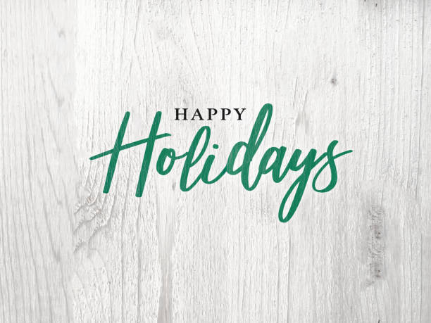 happy holidays calligraphy text over white rustic wood background - happy holidays stock pictures, royalty-free photos & images