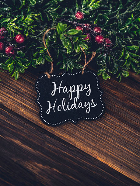 happy holidays gift tag with christmas wreath and berries - happy holidays stock pictures, royalty-free photos & images
