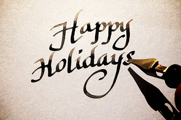 Happy Holidays Greeting Card Message in Old Fashioned Calligraphy stock photo