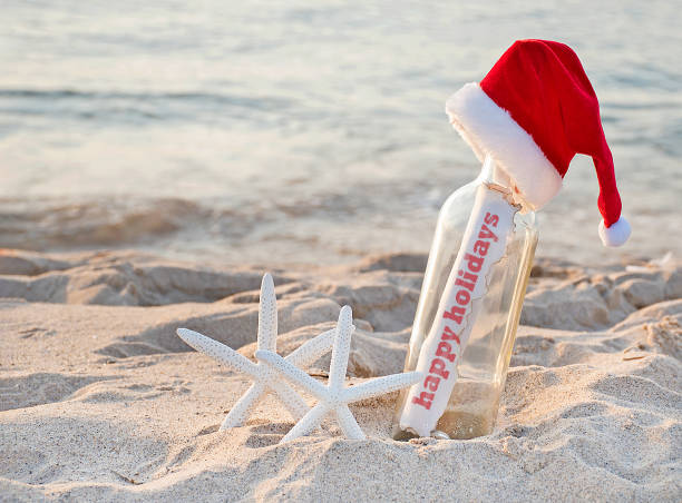 happy holidays greeting with starfish - happy holidays stock pictures, royalty-free photos & images