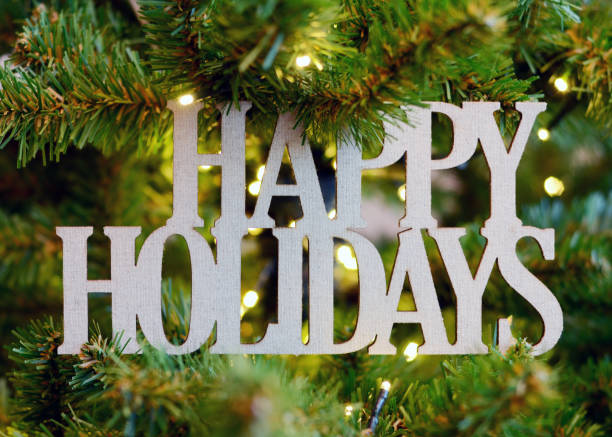 happy holidays message in a christmas tree - happy holidays stock pictures, royalty-free photos & images