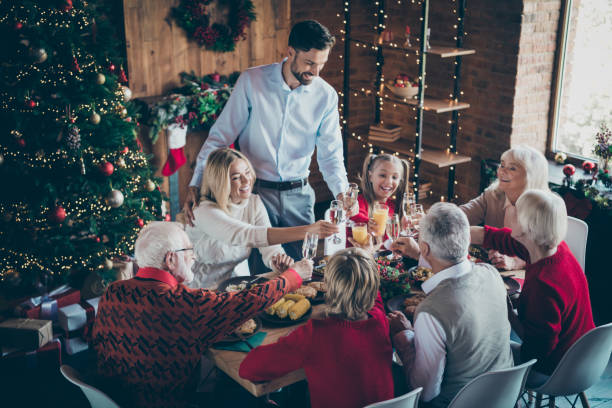 happy holidays! photo of full family eight members gathering sit dinner table telling x-mas toasts clinking glasses multi-generation reunion in newyear atmosphere living room indoors - vacations food stock pictures, royalty-free photos & images